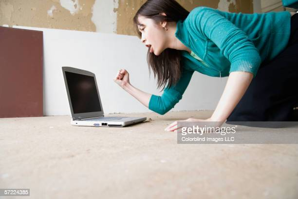 Woman yelling at laptop screen