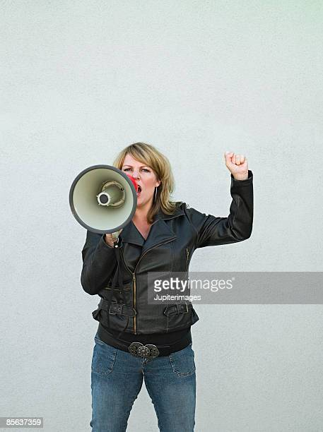 Woman yelling into bullhorn