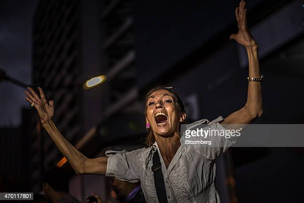 A woman yells at riot police during a demonstration by a group made up of mostly students in Caracas Venezuela on Monday Feb 17 2014 Venezuela's...