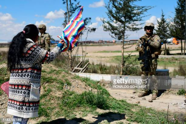Woman yells at soldiers guarding the Senkata fuel plant during the funeral procession of eight supporters of Bolivia's ex-President Evo Morales,...