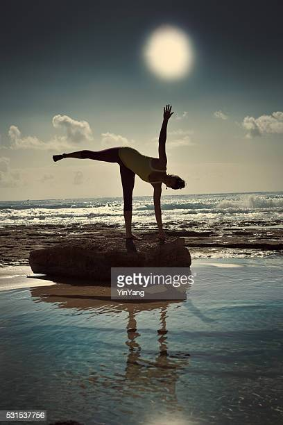 Woman Yoga Exercise in Nature with Sea and Sky Background