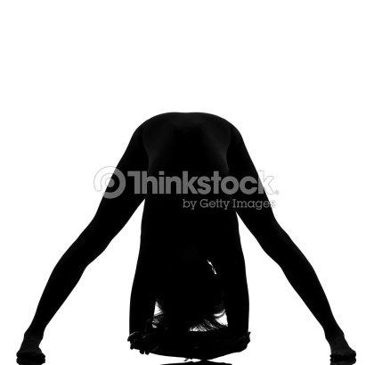 woman yoga prasarita padottanasana pose stretching stock