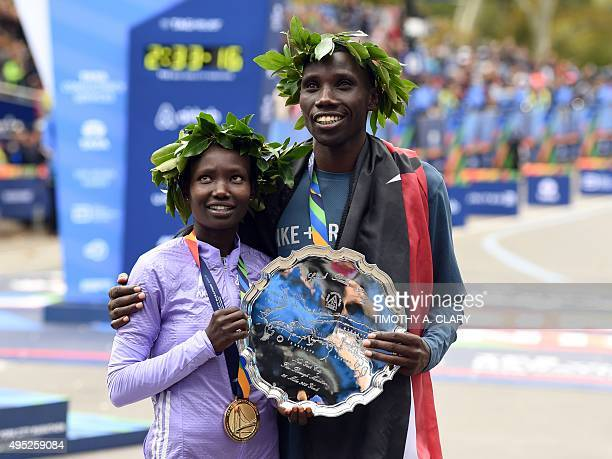 Woman's 1st place finisher Mary Keitany from Kenya and Men's 1st place winner Stanley Biwott from Keyna after winning their divisions in the TCS New...