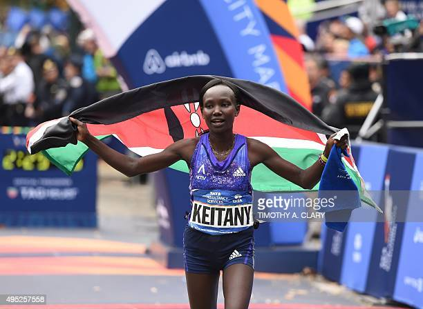 Woman's 1st place finisher Mary Keitany from Kenya crosses the finish line to win the Women's division of the TCS New York City Marathon in New York...