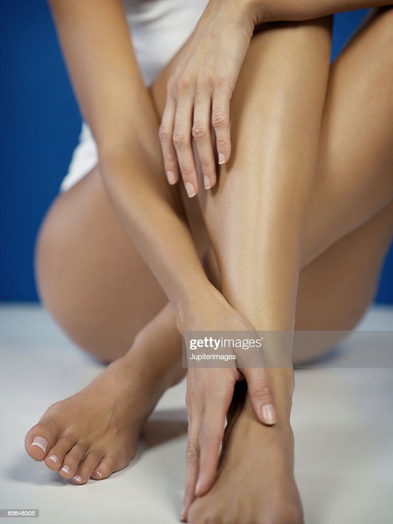 Woman's arms and legs : Stock Photo