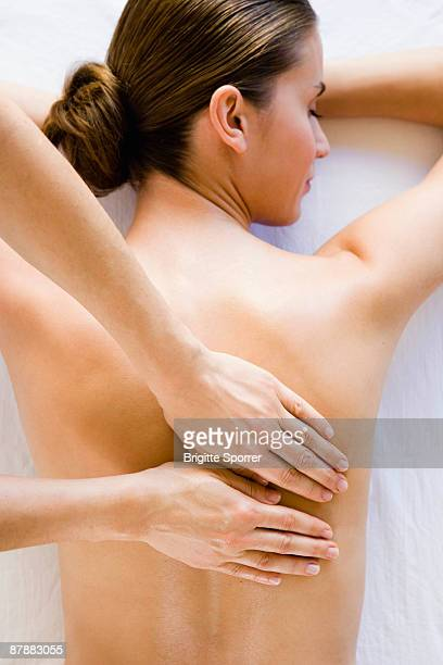 Woman's back being massaged