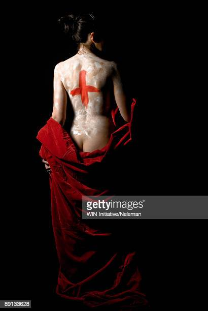 woman's back with a red cross and a red cloth - builders bum stock pictures, royalty-free photos & images
