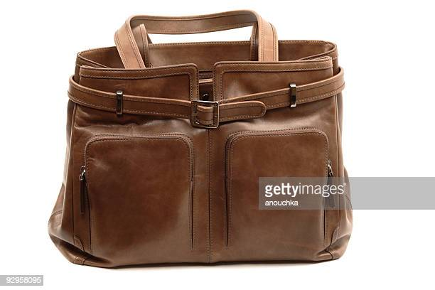 woman's bag - brown purse stock pictures, royalty-free photos & images