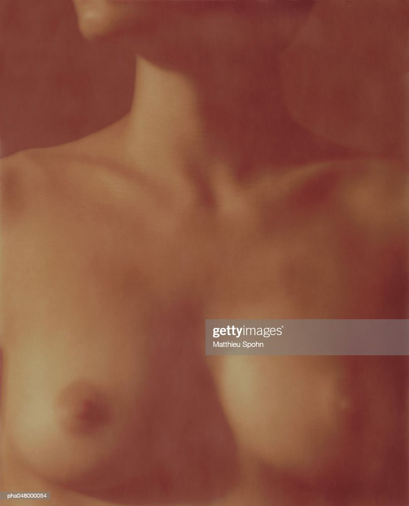 Woman's bare bust, blurred : Stockfoto
