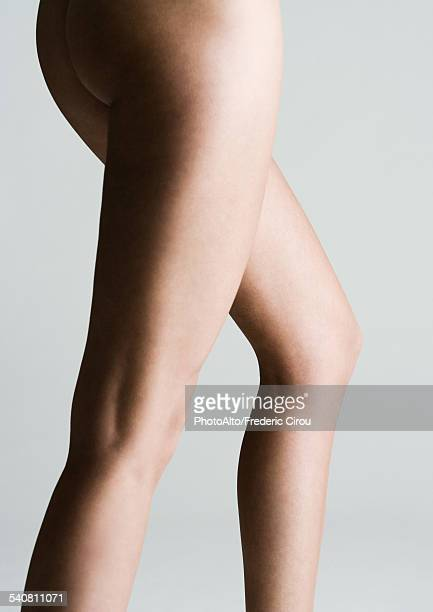 Womans bare buttocks and legs