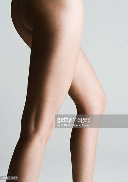 Woman's bare buttocks and legs