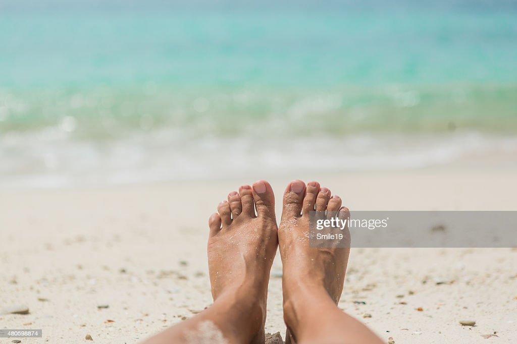 Woman's Bare Feet on the beach : Stock Photo