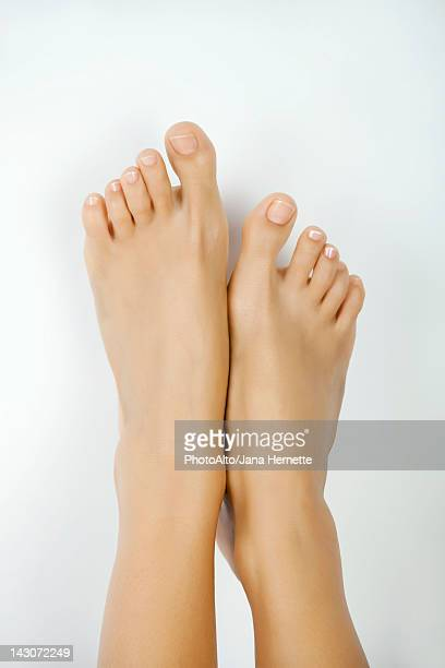 woman's bare feet - pretty toes and feet stock photos and pictures