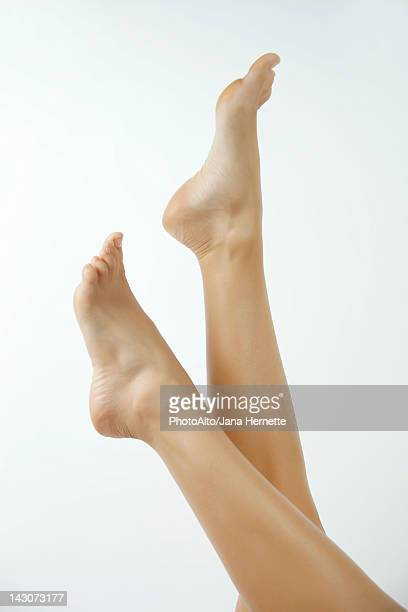 woman's bare feet - beautiful female feet stock photos and pictures