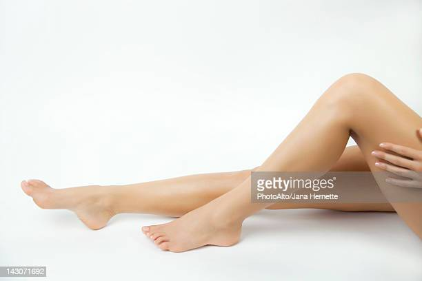 woman's bare legs - beautiful female feet stock photos and pictures