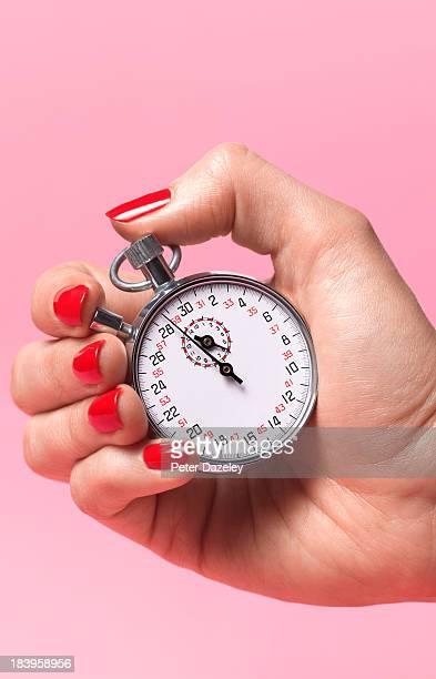 woman's biological watch ticking - woman hurry stockfoto's en -beelden