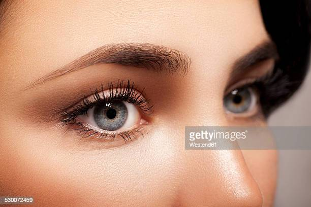 woman's blue eyes - eyebrow stock pictures, royalty-free photos & images