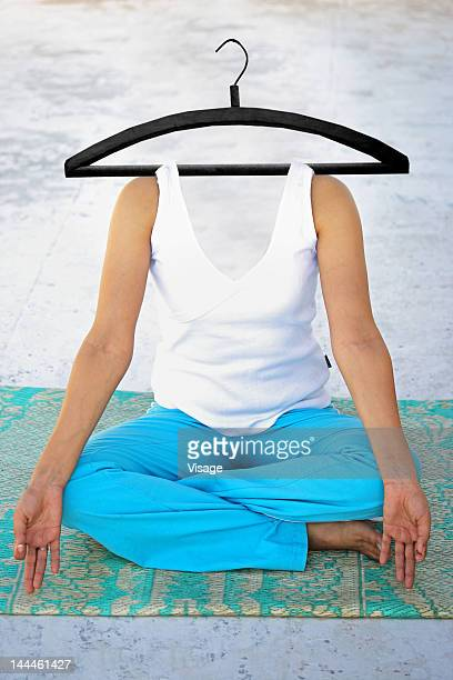 Woman's body suspended to a hanger