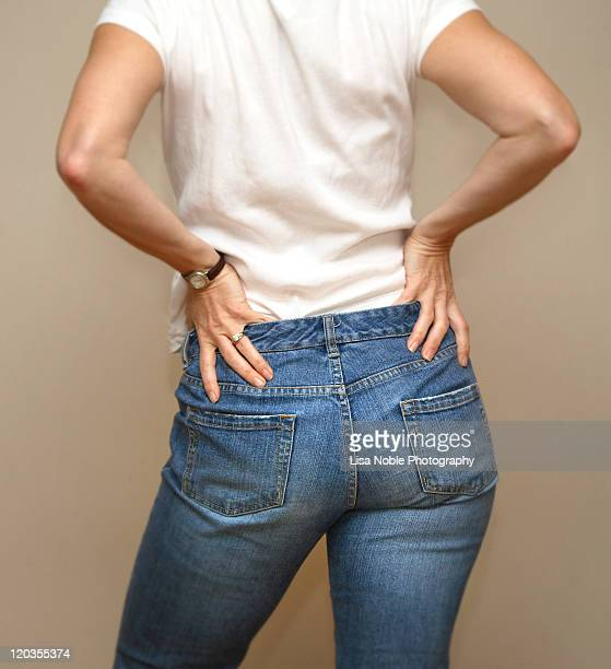 Womans bottom in blue jeans and white T-shirt