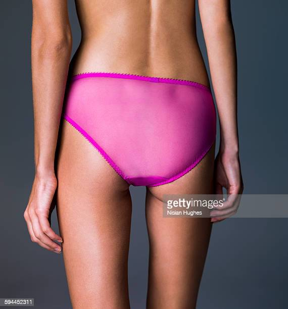 Woman's butt with pink panties