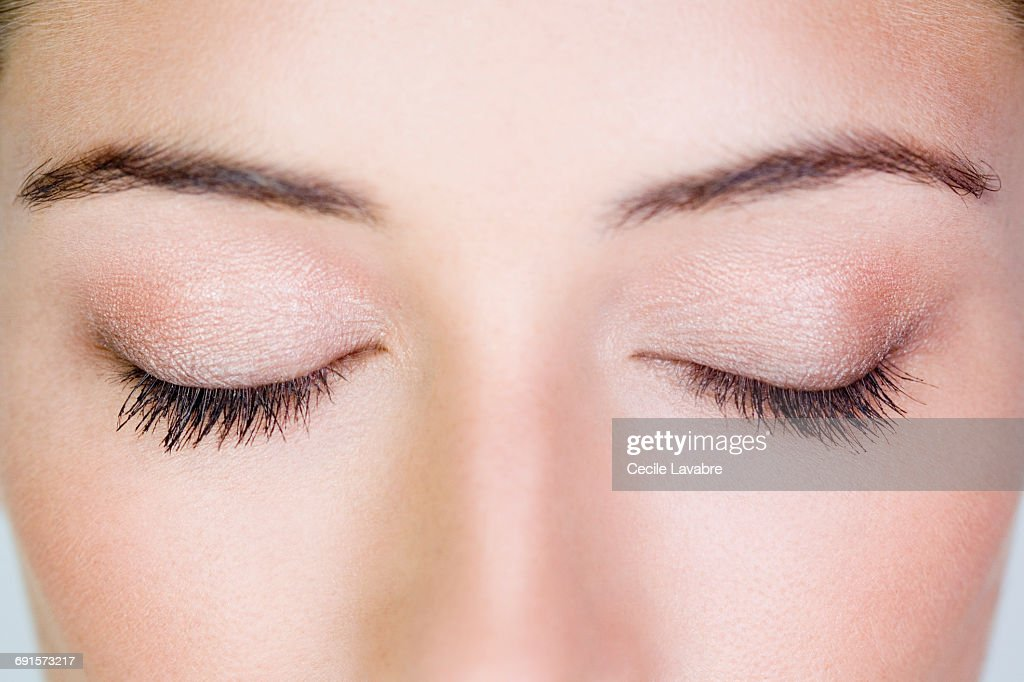 Woman's closed eyes, close-up : Stock Photo