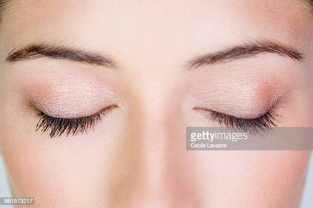 Woman's closed eyes, close-up