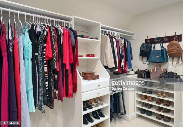 a woman's closet - walk in closet stock photos and pictures