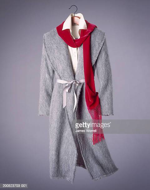 woman's coat and scarf suspended in mid-air - overcoat stock pictures, royalty-free photos & images