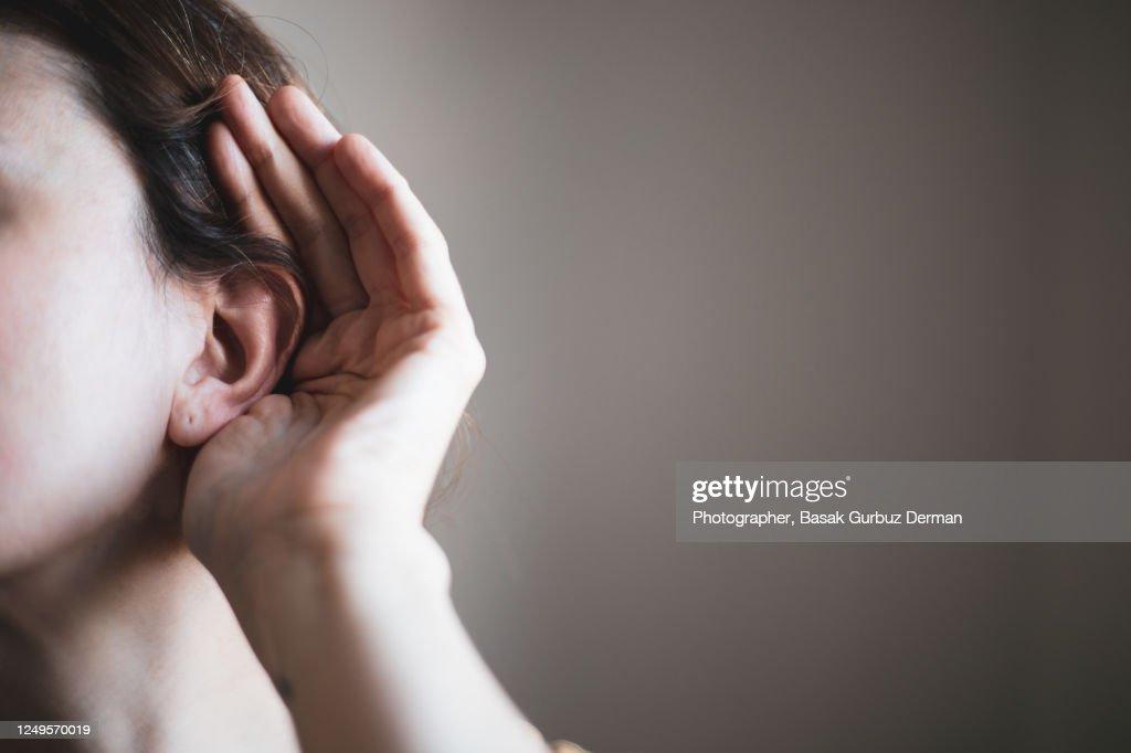 A woman's ear, listening : Stockfoto