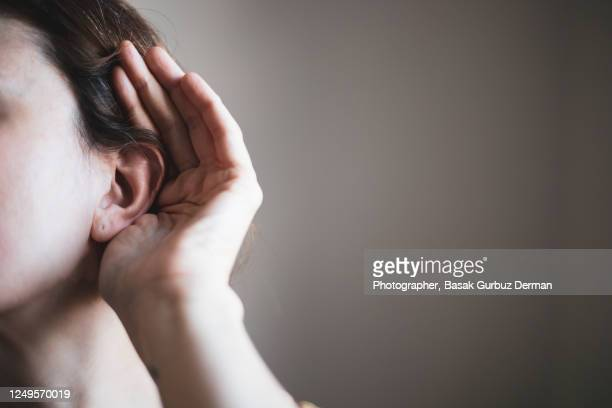 a woman's ear, listening - ear stock pictures, royalty-free photos & images