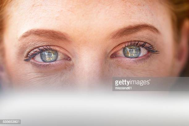 Womans eyes withshopping cart icons