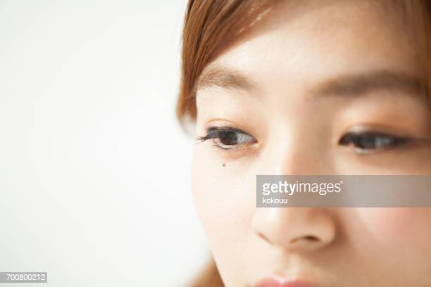 woman's face close up - mole stock photos and pictures