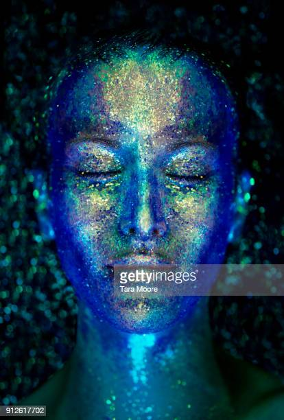 woman's face covered with glitter - body paint stock pictures, royalty-free photos & images