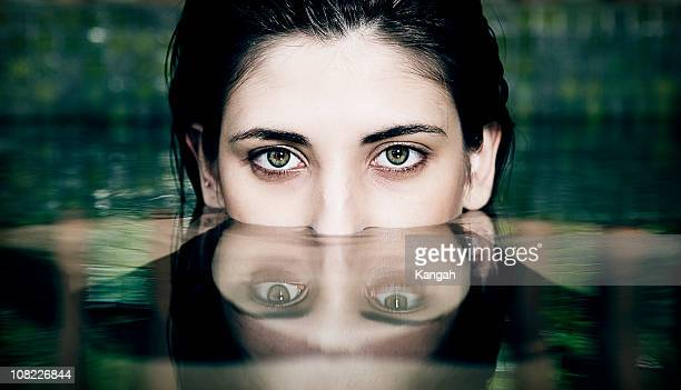 Woman's Face Half Submerged in Water