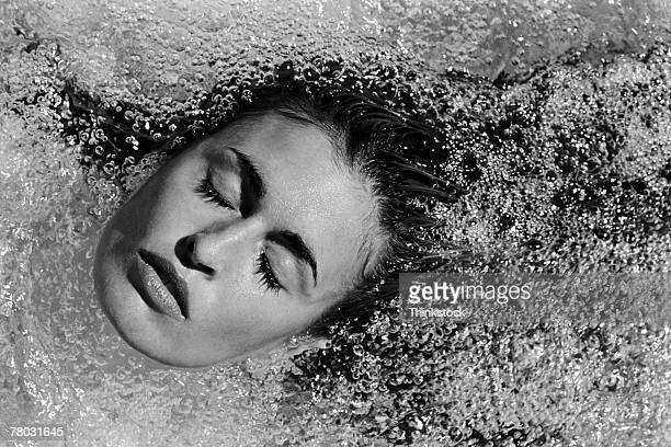 Woman's face in bubbling pool