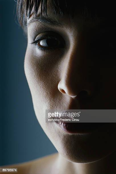 Woman's face in shadow, close-up