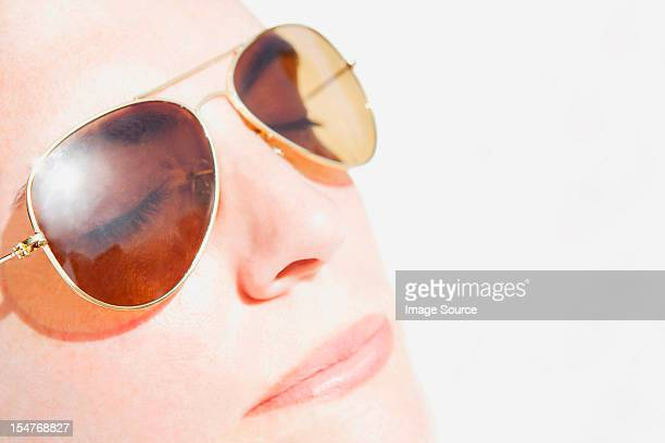 Woman's face in sunlight