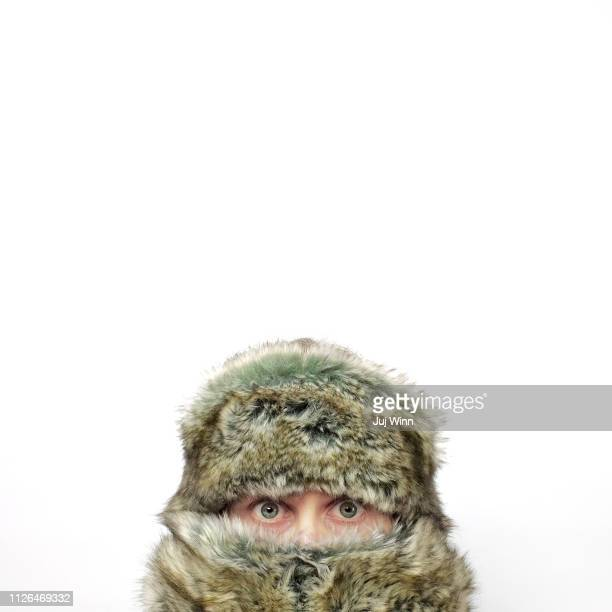 Woman's face in winter hat and scarf
