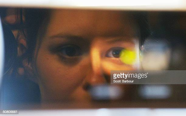 A womans face is reflected as she has her iris scanned by a camera on May 6 2004 in London England Members of the British Home Affairs Select...