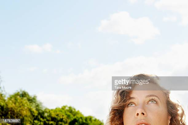 woman's face looking up to sky