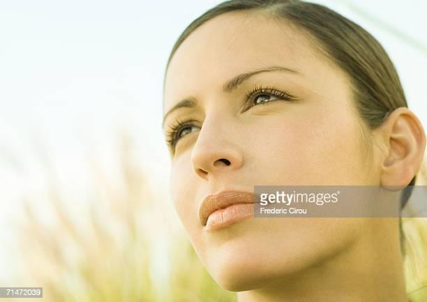 woman's face - 後ろで束ねた髪 ストックフォトと画像