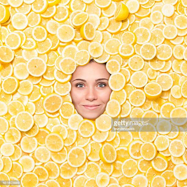 Woman's Face Surrounded With Lemon Slices