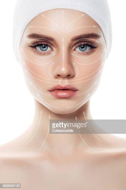 woman's face with arrows as a model of facial massage - botox stock pictures, royalty-free photos & images