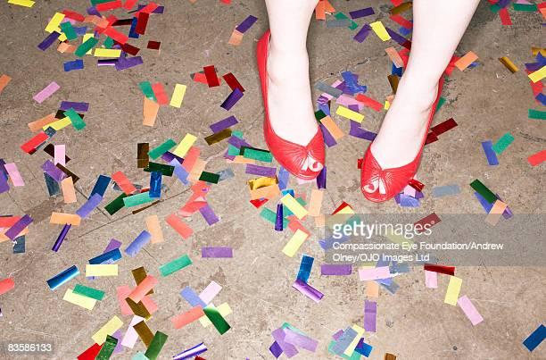 Woman's feet amongst confetti