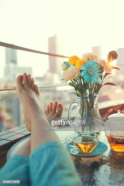 Woman's feet and flower