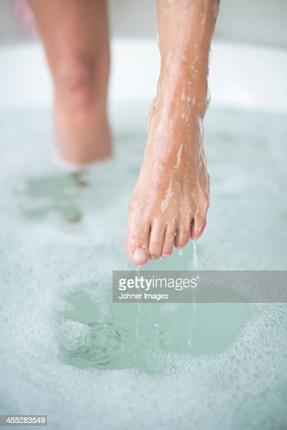 womans feet in bath - hot legs stock photos and pictures