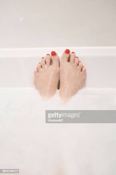 woman's feet in bath - bubble bath stock pictures, royalty-free photos & images
