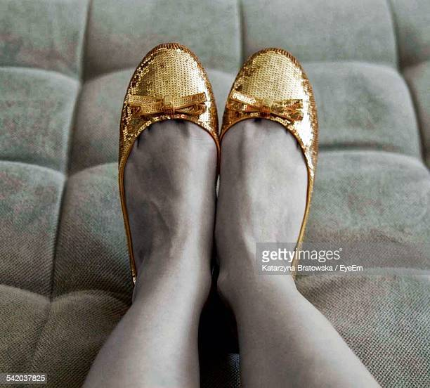 Womans Feet In Gold Shoes