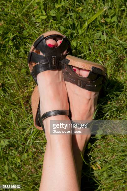 Woman's Feet in Sandals on Grass