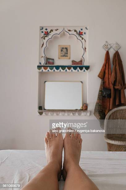 Woman's feet lying in a bed